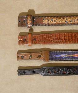 """Top: Filigree belt with no taper. 2: Alligator belt with custom taper. 3: Horsehair belt with 1"""" taper. Bottom: Filigree belt with 3/4"""" taper."""