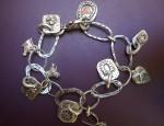 Margaret Sullivan – Sterling and 14kt Gold Charm Bracelet