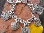 (sold) Sterling Silver and 14K Gold Horseshoe Theme Charm Bracelet